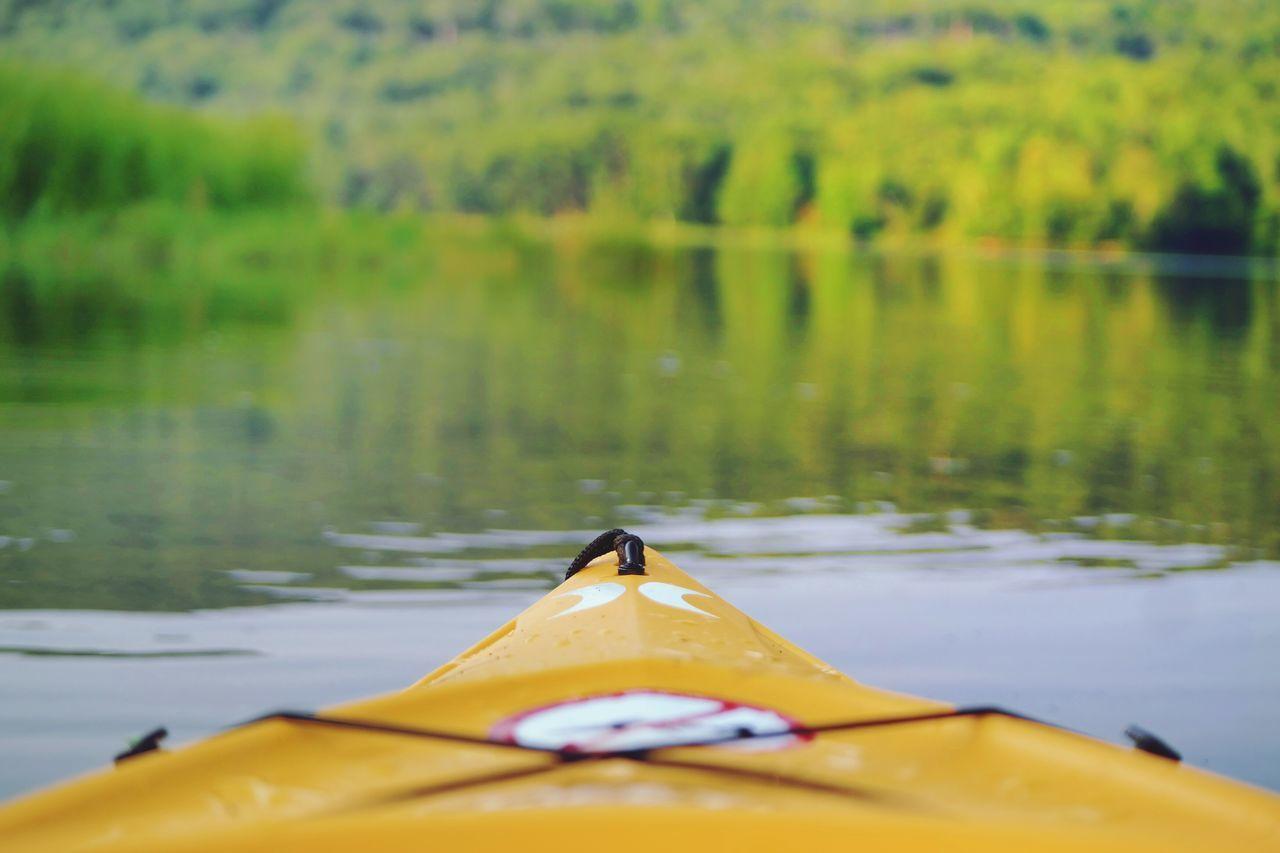 Close-up of yellow kayak on river