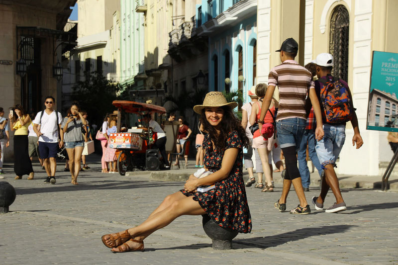 A beautiful road in Havana Vieja Been There. Cuba Hat Havana Travel Photography Traveling Architecture Building Exterior Casual Clothing City Day Girl Smiling Girl With Hat Leisure Activity Lifestyles Men Outdoors People Street Walking Women Young Adult Young Women