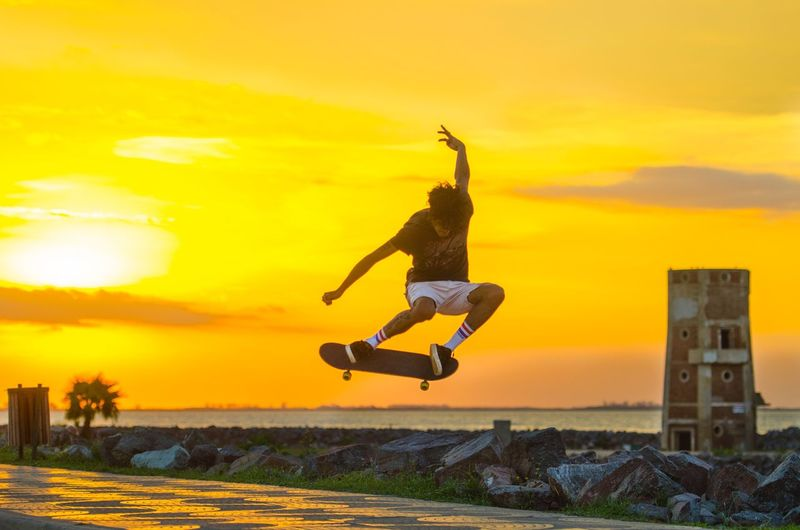 Action Skateboarding Sky Sunset Cloud - Sky Jumping Full Length Real People Mid-air Motion Outdoors Sunlight Fun