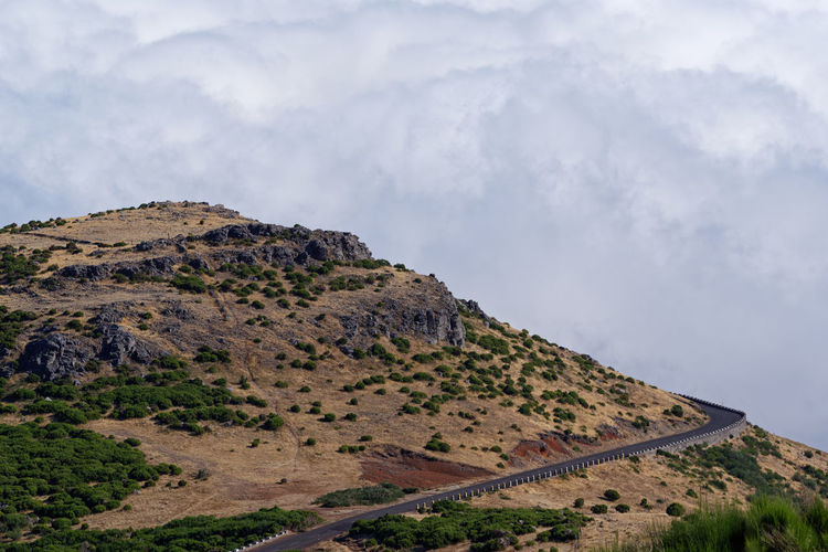 Road on the mountain peak against dense clouds Mountain Sky Scenics - Nature Cloud - Sky Beauty In Nature Tranquil Scene Non-urban Scene Tranquility Landscape No People Nature Mountain Range Rock Land Day Idyllic Outdoors Rock - Object Mountain Peak Road Empty Road Dense Clouds Madeira Pico Do Arieiro Hiking