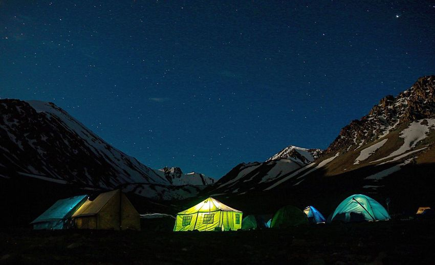 Tent against blue sky at night