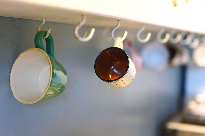 Cups and hooks Kitchen Hooks Mugs Cups Hanging No People Close-up Indoors  Day