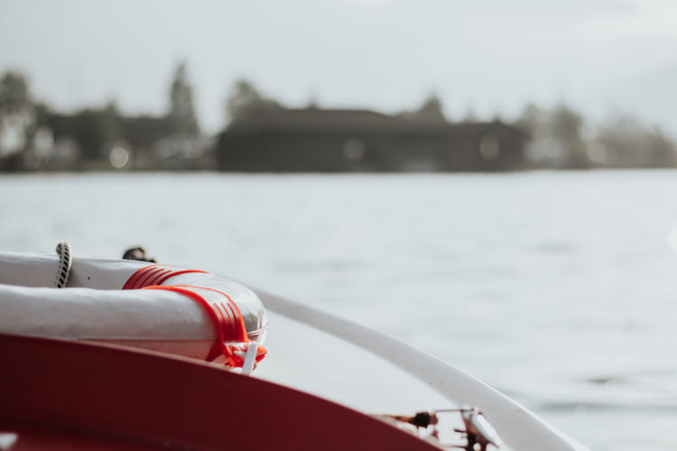 Close-up of red boat on lake