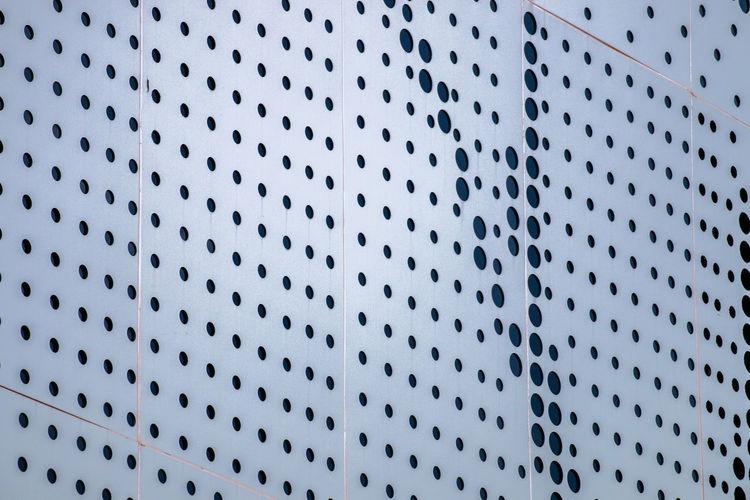 Low angle view of metallic wall