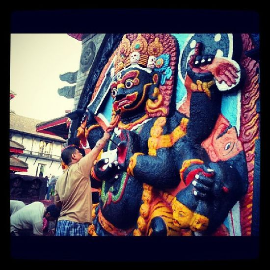 Artist painting the famous Kaal Bhairava sculpture in Basantapur Hanumandhoka Dashain is in full swing. from Gods to humans all have new dresses picoftheday