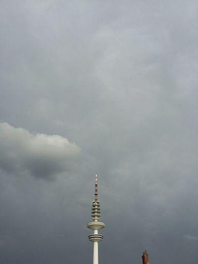 Heinrich-Hertz-Turm Hamburg with Chimney or such. · Germany 040 Hamburgmeineperle Radio Tower Fernsehturm Tower Landmark Cut Off  Gray Sky Rain Clouds Rain☔ Clouds And Sky Beautiful Day