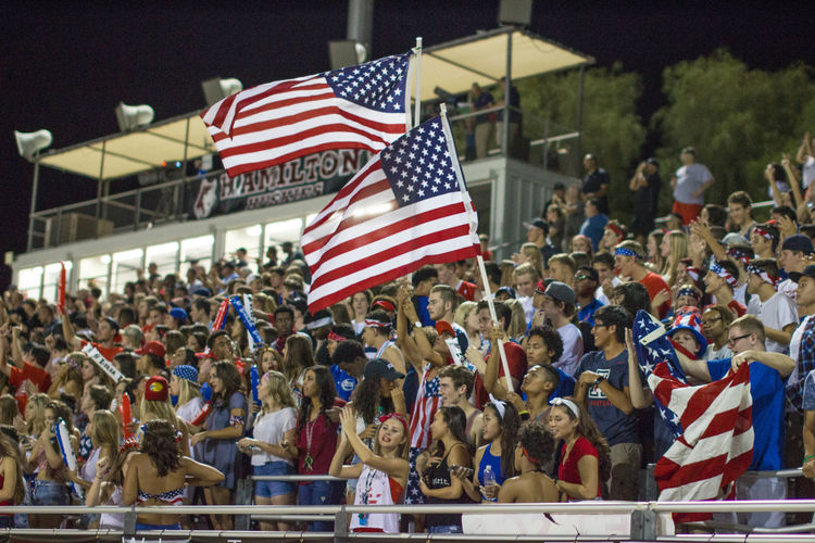 American Flag Crowd Flag Football Football Game Gathered High School High School Memories Large Group Of People National Flag Outdoors Patriotism School Spirit Sitting Spectator Student Section Yearbook