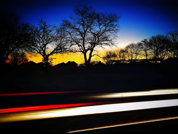 Perspectives On Nature EyeEm Best Shots EyeEm Selects Huawei Photography Long Exposure Light Trail Oo P10 Plus Photography Long Exposure Shot Double Exposure Car Light Trails Light Painting Snapseed Vignette Sunrise Mobile Photography Silhouette Tree Road