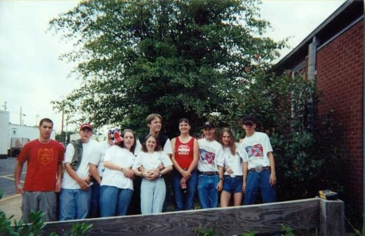 This is an old picture of me back in high school. The South to me means friends and family that you can run wild with and love. Yes we wore Confederateflag Rebel Flag because we were proud of who we are. Southerngirl born and raised, wouldn't have it another way.