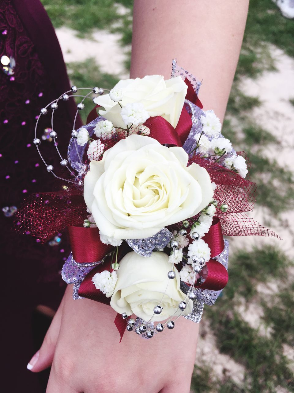 real people, flower, one person, human hand, human body part, rose - flower, holding, women, bouquet, outdoors, leisure activity, day, lifestyles, bracelet, close-up, fragility, bride, focus on foreground, wedding, nature, flower head, life events, beauty in nature, freshness, wedding dress, adult, people