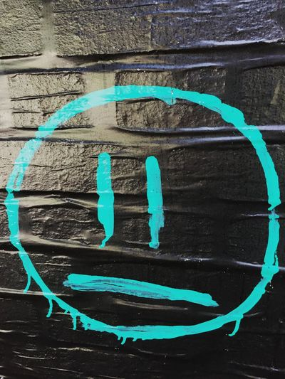 Wall - Building Feature Paint Graffiti Brick Wall Spray Paint No People Weathered Outdoors Communication Built Structure Day Architecture Textured  Full Frame Close-up Smile Turquoise Dripping Face Painted Berlin