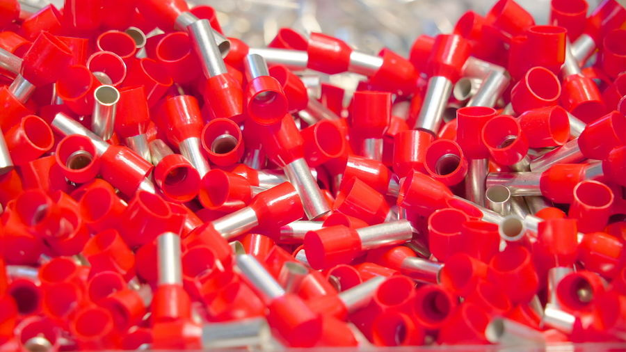 Lots of red bolts on the glass stall these tiny tools are one of the many electrical tools in display Red Close-up Large Group Of Objects No People Abundance Indoors  Full Frame Plastic Backgrounds Still Life Selective Focus Group Thumbtack Metal Office Supply Sharp Shape Healthcare And Medicine Repetition Design Excess Electricity  Equipment Technology Control Protection Safety Energy Industry Circuit System Industrial
