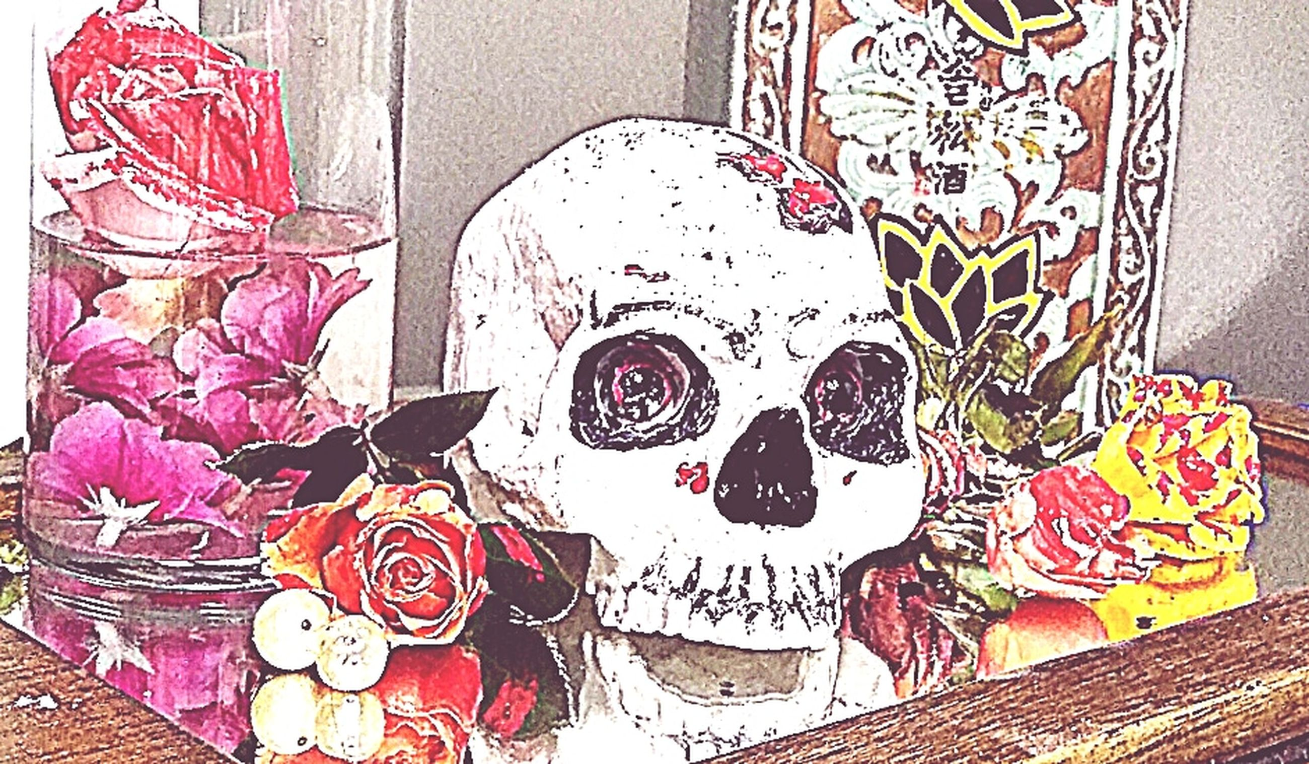 representation, creativity, no people, art and craft, disguise, human representation, mask, celebration, human skeleton, close-up, mask - disguise, skeleton, indoors, halloween, event, still life, spooky, carnival - celebration event, festival, floral pattern