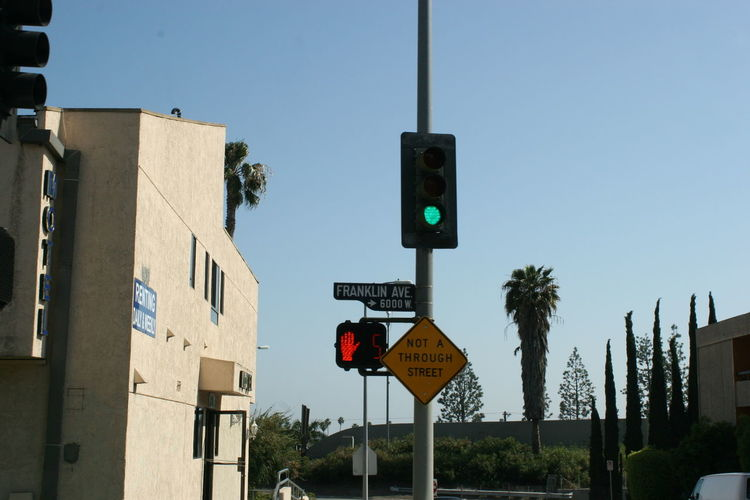 Green Traffic Light on Franklin Ave., Los Angeles Architecture Clear Sky Communication Day Direction Franklin Ave. Green Traffic Lights Guidance Los Angeles, California Low Angle View No People Not A Through Street Outdoors Red Traffic Light Road Sign Signal Sky Stoplight Tree West Hollywood