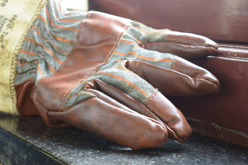 glove in window Shoe One Person Close-up Indoors  Human Body Part Leather High Angle View Low Section Real People Old Dirt Dirty Human Hand Human Leg Body Part Relaxation Day Furniture Human Foot