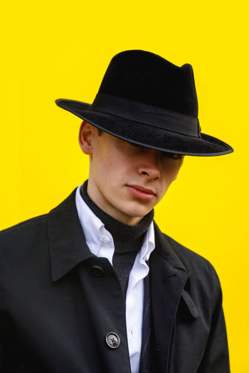 London Fashion Week Mens 2019 Redefining Menswear Clothing Hat One Person Portrait Yellow Front View Headshot Young Men Young Adult Suit Lifestyles Real People Men Wall - Building Feature Colored Background Formalwear Uniform Menswear Mensfashion Street Style Fashion Fashion Photography London Fashion Stories