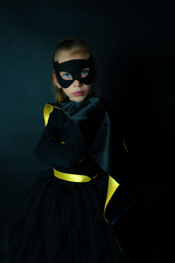 portrait of a child dressed as a superhero Cool Dark Funny Power Super Superhero Background Black Child Childhood Costume Cute Dressing Up Girl Kid Mask Portrait Posing This Is Aging The Portraitist - 2018 EyeEm Awards