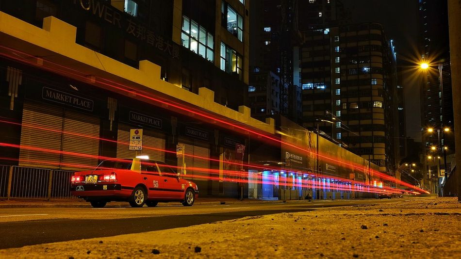light trail of a red night taxi in Hong Kong Hong Kong HongKong Hongkong Photos Night Street Nightphotography Road Taxi Transportation Cap City Night Light Trace Light Trail Long Exposure Night Night Traffic Nightscape No People Red Lips Red Train Speed Street Photo Streetphotography Transportations Urban Scape X100t First Eyeem Photo