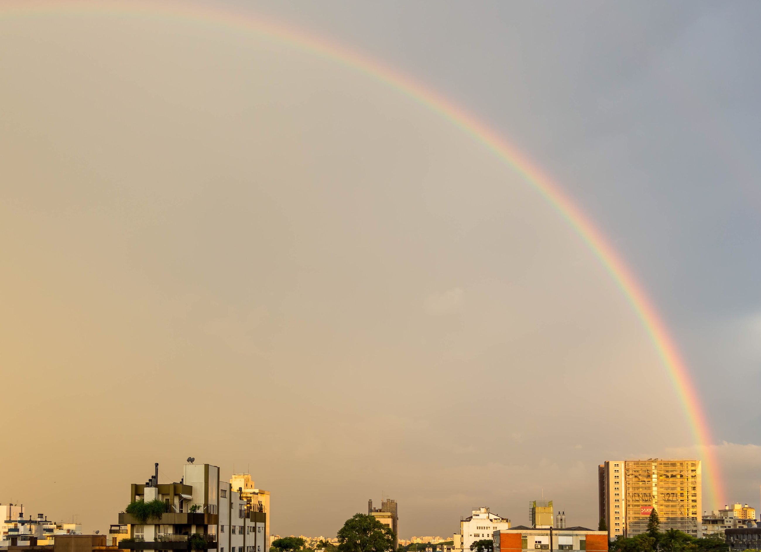 rainbow, building exterior, cityscape, architecture, city, built structure, outdoors, scenics, no people, sky, double rainbow, beauty in nature, urban skyline, nature, day