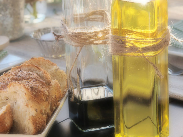 Extra virgin olive oil with bread on table
