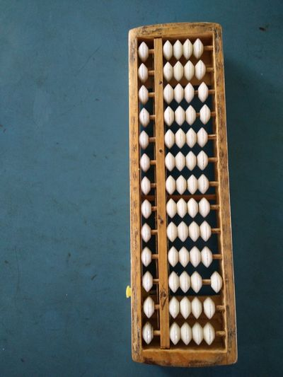 High angle view of abacus calculator on table