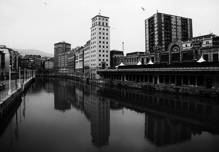 Café FEVE. Architecture Bilbao Black & White Black And White Blackandwhite Photography Building Building Exterior Built Structure Canal Capital Cities  City E-M1 Euskadi Olympus Olympus OM-D EM-1 OM-D Outdoors Reflection River SPAIN Water