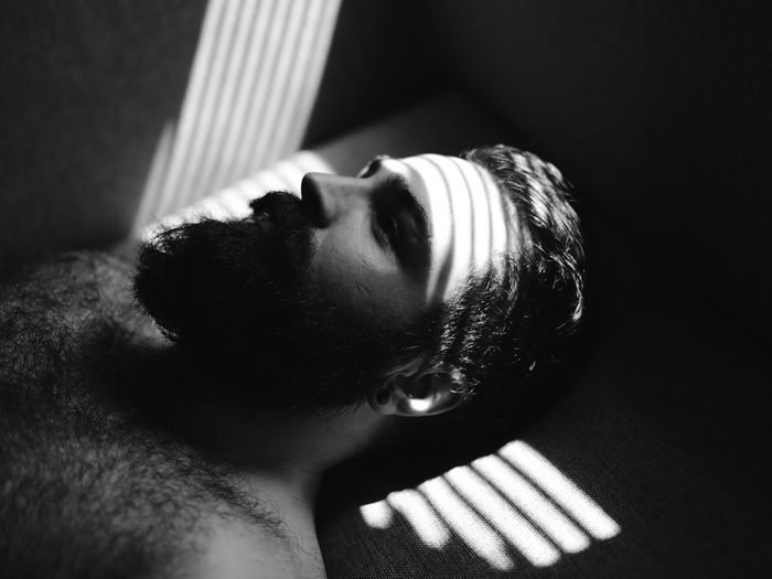 Close-Up Of Bearded Man With Shadow