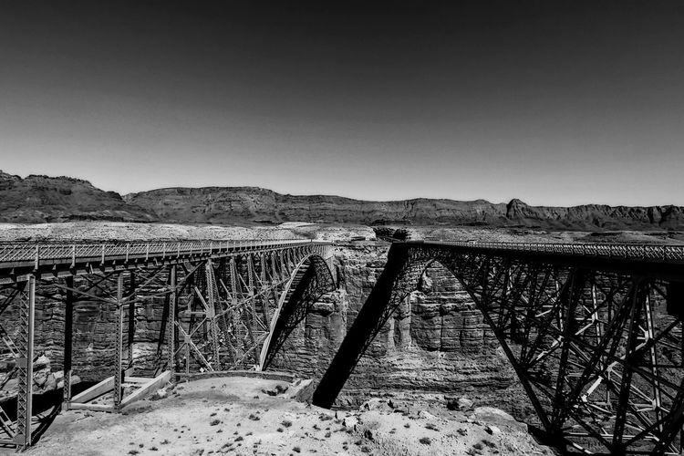 Navajo bridge at marble canyon against clear sky
