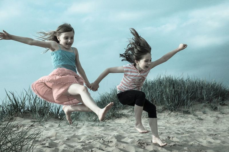 Happiness Happy Happiness Happy Kiss Day Check This Out Enjoying Life Taking Photos Childhood Child My Year My View Kids Kidsphotography Original Experiences Kids Having Fun People Together Children Photography Twins TWINS ♥ Twin Sisters The Great Outdoors - 2016 EyeEm Awards Jumping The Essence Of Summer Sand Playing On The Beach Beach The Essence Of Summer- 2016 EyeEm Awards