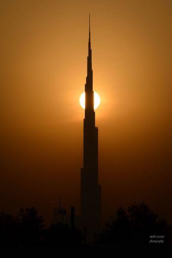 Sunrise on Burj Khalifa Sky Silhouette Architecture Built Structure Tower Orange Color No People Sun Outdoors Building Travel Destinations