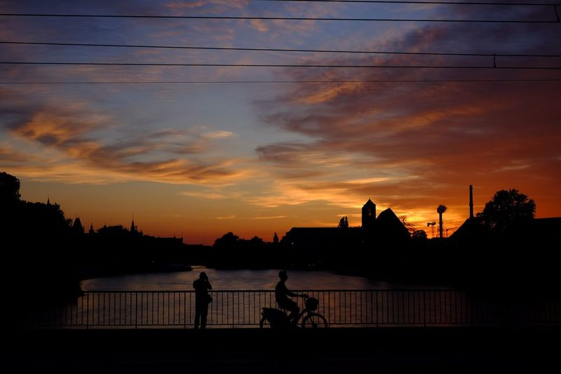 Sunset silhouette Sunset Sky Cloud - Sky Silhouette Orange Color Architecture Water Outdoors Lifestyles Leisure Activity Tranquil Scene