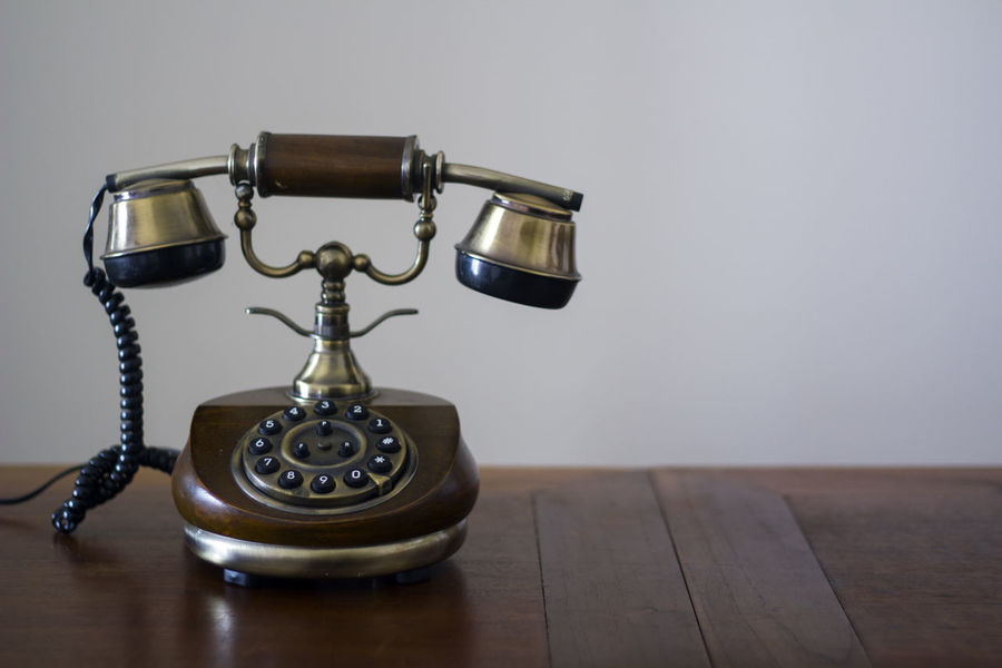 Vintage phone on wooden table Antiquated Antique Classic Copy Space Retro Antique Call Communication Connection Dial Handset Landline Phone No People Number Old Old Telephone Phone Retro Styled Style Table Technology Telecommunications Equipment Telephone Vintage Wood - Material