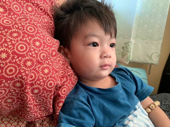 Childhood Child Cute Innocence Real People Indoors  Bed Portrait Toddler  Lifestyles Casual Clothing Males  Furniture People Family Relaxation Front View Looking Away Babyhood