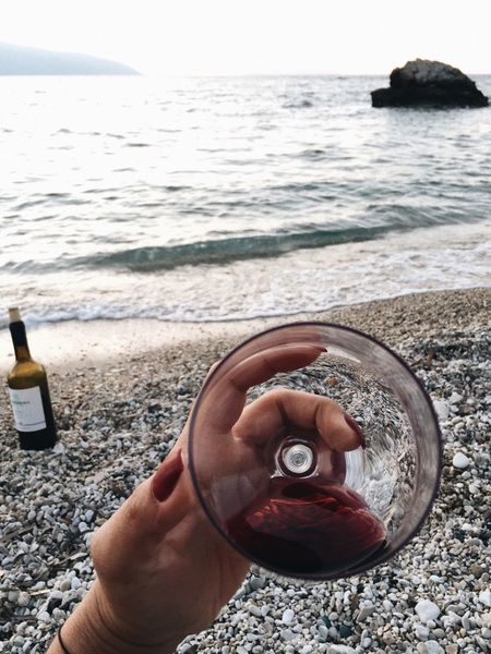Sea One Person Water Human Body Part Human Hand Real People Beach Holding Drink Lifestyles Sand Leisure Activity Day Outdoors Horizon Over Water Men Close-up Alcohol Nature
