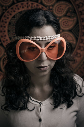 Dark Hair Disguise Portrait Of A Woman Beauty Eyeglasses  Fake Smile Feeling Sad Feelings Front View Hidden Feelings Hippie Huge Glasses Indoors  Marocco One Person People Portrait Pretty Girl Real People Sad Sadness Sunglasses Young Adult Young Woman
