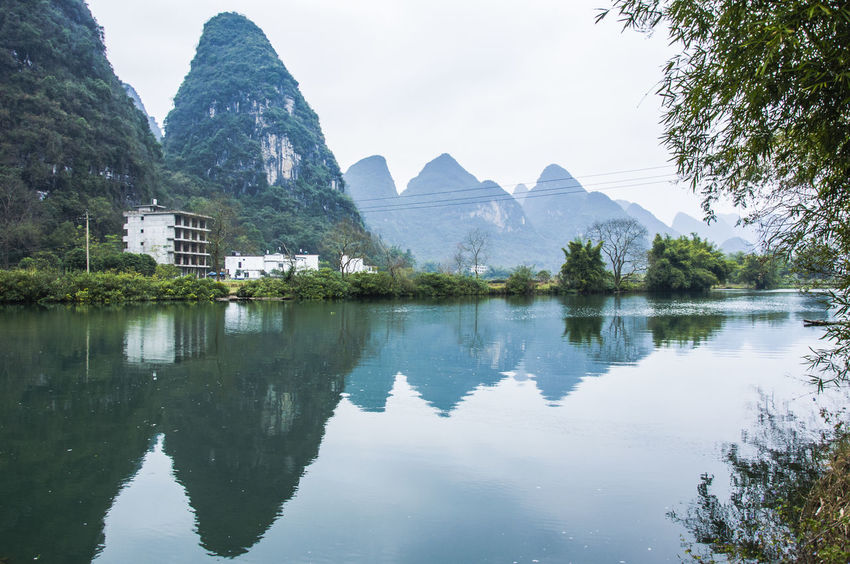 Beautiful Yulong River scenery Guilin, Guangxi, China Natural Beauty Nature Peace And Quiet Scenic Yangshuo, Yulong River Beauty In Nature Countryside Day Lake Landscape Nature Outdoors Picturesque Reflections In The Water River Riverscape Rural Scene Scenery Sky Tranquility Travel Destinations Tree Water