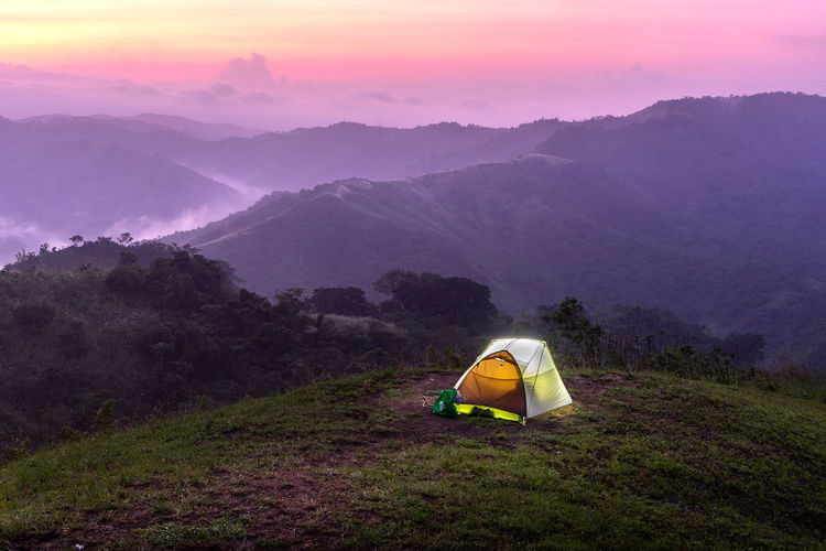 High angle view of tent on mountains against sky during sunset