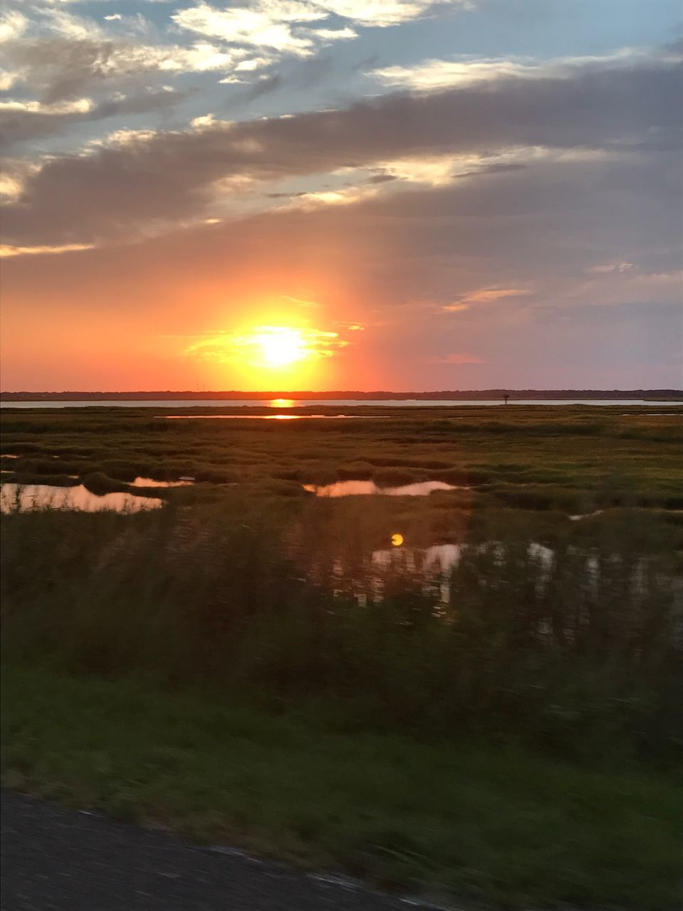 sunset, sun, scenics, nature, tranquil scene, beauty in nature, orange color, tranquility, sky, landscape, no people, cloud - sky, outdoors, water, field, sunlight, grass, day
