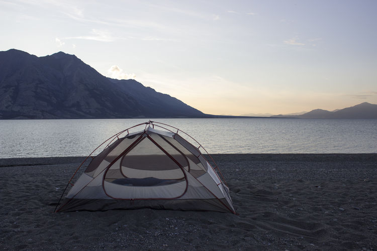 Tent on beach at sunset Camping Sunset_collection Beach Beachphotography Beauty In Nature Camp Cloud - Sky Day Idyllic Land Mountain Mountain Range Nature No People Non-urban Scene Sandy Beach Scenics - Nature Sea Sky Sunset Tent Tent On Beach Tranquil Scene Tranquility Water