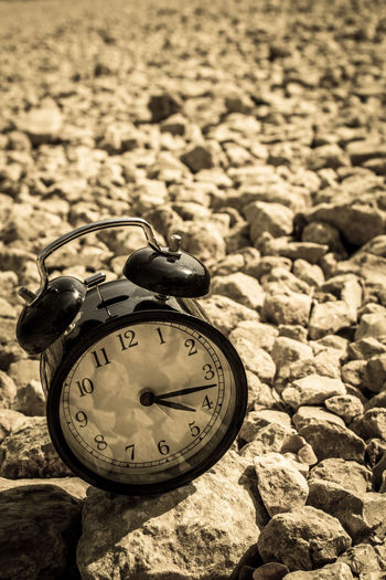 Close-up of clock on stone wall