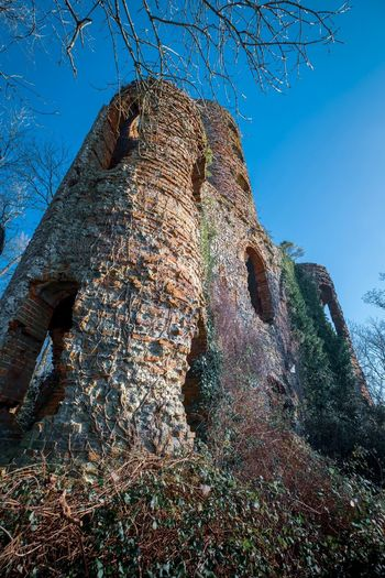 Architecture Derelict Haunted Castle Ruined EyeEm Selects Sky Nature Low Angle View No People Blue Day Sunlight Clear Sky Outdoors Beauty In Nature Growth Close-up Built Structure