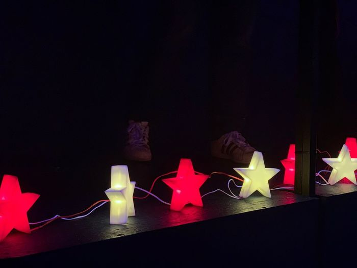 Festive stars negative space Festive Season Atmospheric Mood Stars Xmas Decorations Christmas Decoration Christmas Decoration Illuminated Luminous Wired Black Background Indoors  No People Celebration Still Life Event Multi Colored Creativity Arrangement Decoration Red