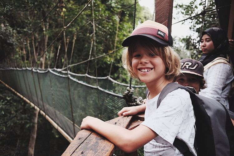 A Smile is the Prettiest Thing You Can Wear Norirwandyariffin Kota Kinabalu Hereandthere Moment Travel Fujifilm Fujifilm_xseries Togetherness People Smiling Day Outdoors Child Cheerful Nature Adventure Tree Forest Real People