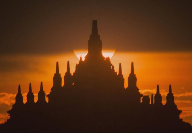 Silhouette of temple during sunset