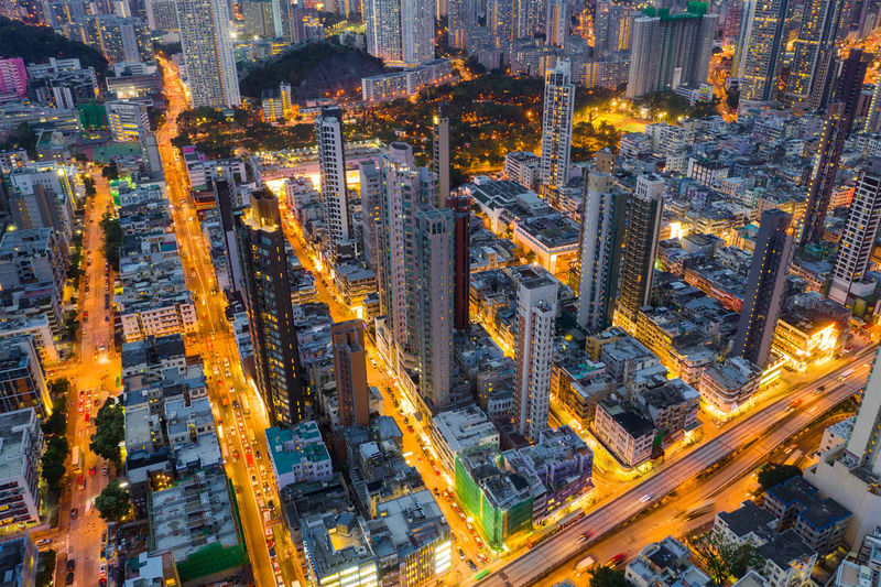Top down view of Hong Kong downtown city City District Town Panoramic Kowloon Side Residential  Apartment Flat House Real Estate Public Building Skyline Cityscape Urban High Life Skyscraper Office Downtown Landmark Dusk Top View Aerial Fly Drone  Over Above Down Top Down Bird Eye Hk Hong Kong Hong Kong