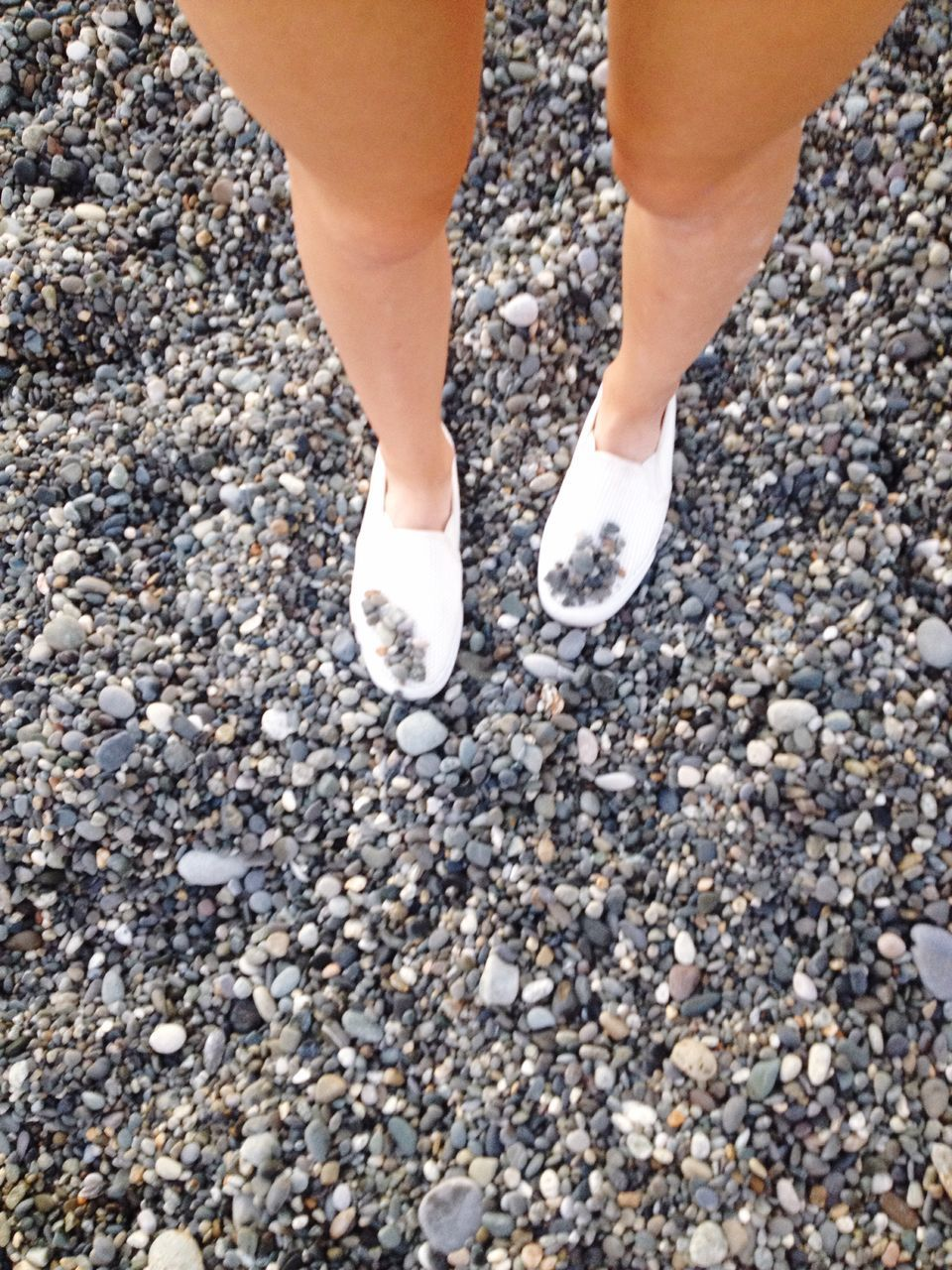 low section, pebble, real people, one person, day, human leg, standing, human body part, outdoors, close-up, nature, pebble beach, people