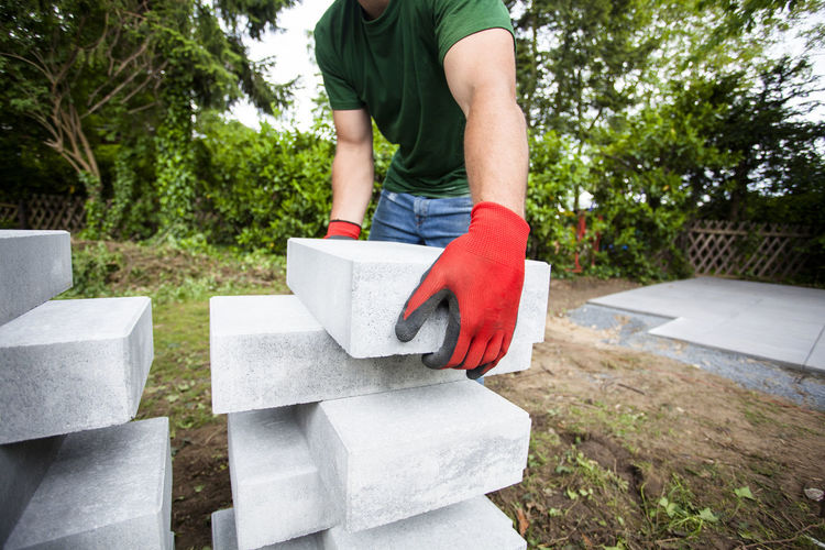 Construction Heavy Home Improvement Lifting Man Planning Worker Working Brick Building Close-up Concrete Creating Garden Gloves Holding Outdoors Piece Posture Preparation  Project Real People Safety Strong Weight