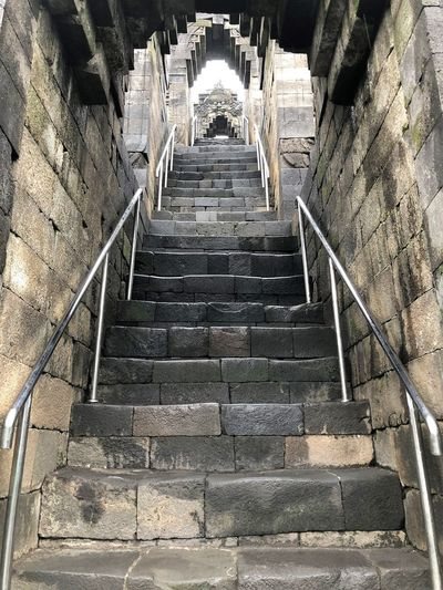 Staircase Architecture Railing Steps And Staircases The Way Forward Direction Built Structure No People Low Angle View Day Indoors  Empty Moving Up Building Wall - Building Feature Sunlight Diminishing Perspective Old