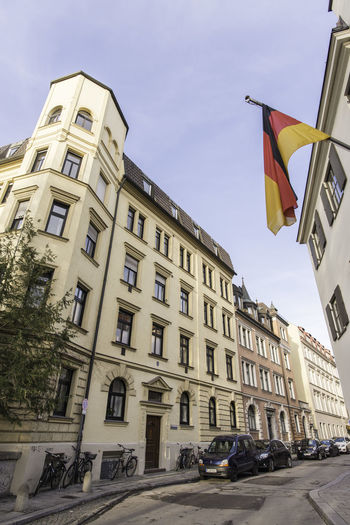 Low Angle View Of German Flag On Building In City