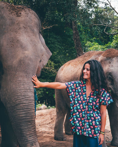 Elephant Tree Mammal Young Adult One Person Standing Real People Front View Plant Day Animal Wildlife Lifestyles Young Women Casual Clothing Three Quarter Length One Animal Nature Animal Trunk Outdoors Hairstyle
